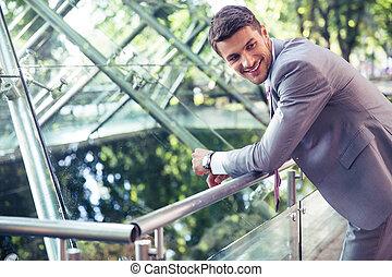 Portrait of a smiling businessman outdoors