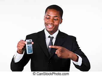 Portrait of a smiling businessman showing a calculator