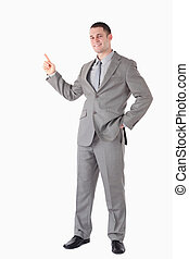 Portrait of a smiling businessman pointing at something