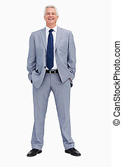 Portrait of a smiling businessman with his hands in his pockets