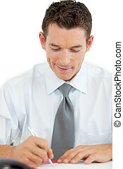 Portrait of a smiling businessman writing