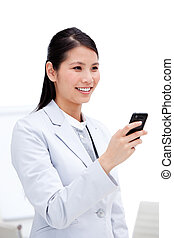 Portrait of a smiling businesswoman looking at his phone