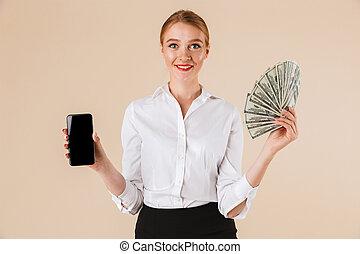 Portrait of a smiling businesswoman showing money