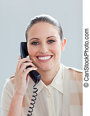 Portrait of a smiling businesswoman talking on phone in the...