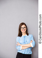 Portrait of a smiling  businesswoman with arms folded