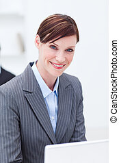 Portrait of a smiling businesswoman working
