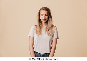Portrait of a smiling casual girl looking at camera