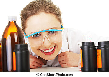 Portrait of a smiling chemist working