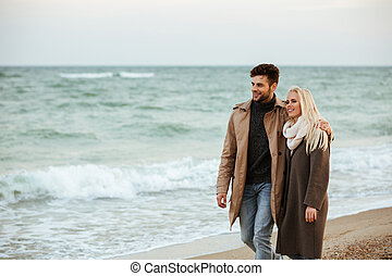 Portrait of a smiling couple in love hugging