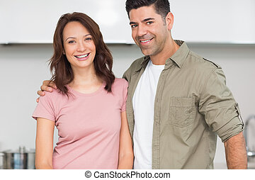 Portrait of a smiling couple in the kitchen