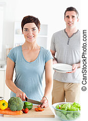 Portrait of a Smiling Couple preparing lunch