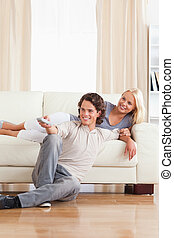 Portrait of a smiling couple watching TV