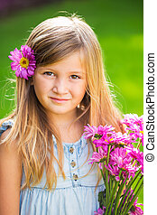Portrait of a smiling cute little girl with flowers