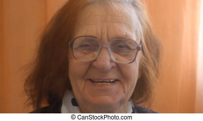 portrait of a smiling elderly woman looking at the camera