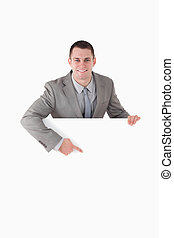 Portrait of a smiling entrepreneur pointing at something