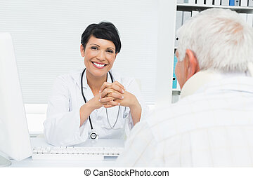 Portrait of a smiling female doctor with senior patient