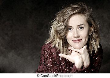 portrait of a smiling girl in a dark Studio