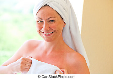 portrait of a smiling girl in a towel