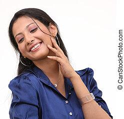 smiling girl in blue collar shirt