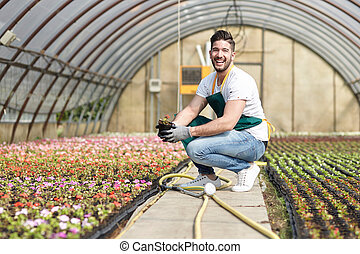Portrait of a smiling greenhouse worker
