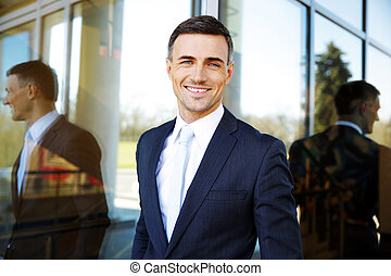Portrait of a smiling handsome businessman in suit
