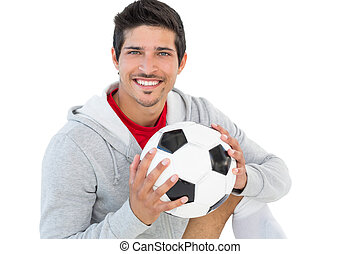 Portrait of a smiling handsome football fan