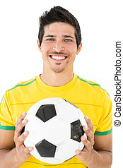 Portrait of a smiling handsome football player