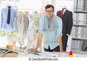 Portrait of a smiling handsome male fashion designer