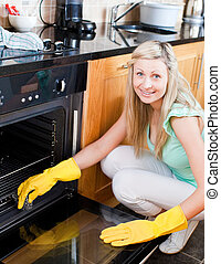 Portrait of a smiling housewife cleaning