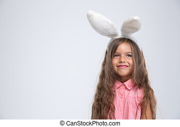 Portrait of a smiling little girl with bunny ears