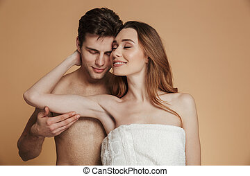 Portrait of a smiling loving shirtless couple