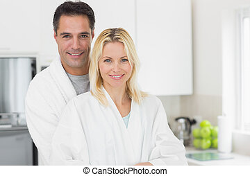 Portrait of a smiling man and woman in the kitchen