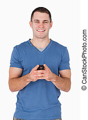 Portrait of a smiling man holding his mobile phone