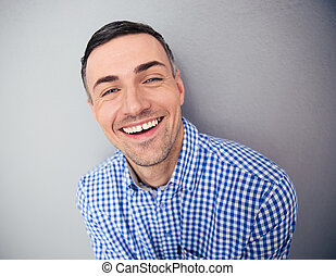 Portrait of a smiling man looking at camera