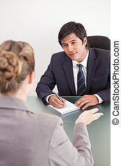 Portrait of a smiling manager interviewing a female applicant