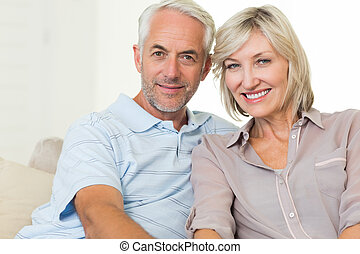 Portrait of a smiling mature couple at home