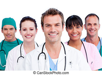 Portrait of a smiling medical team against a white ...