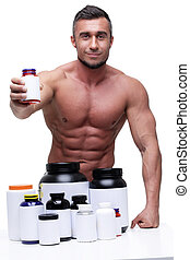 Portrait of a smiling muscular man with sports nutrtion