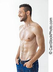 Portrait of a smiling muscular shirtless man