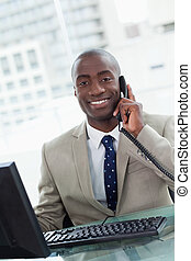 Portrait of a smiling office worker making a phone call