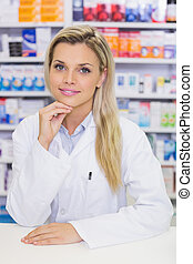 Portrait of a smiling pharmacist looking at camera