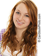 portrait of a smiling redhead woman in bavarian dress on white background