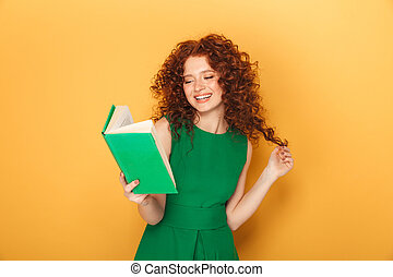 Portrait of a smiling redhead woman in dress