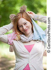Portrait of a smiling redhead woman
