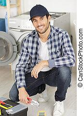 portrait of a smiling repairman