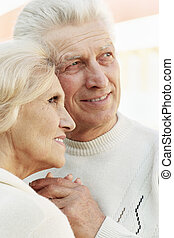 Portrait of a smiling senior couple hugging
