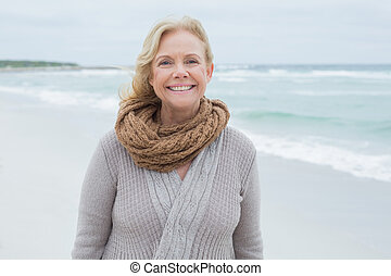 Portrait of a smiling senior woman at beach