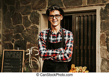 portrait of a smiling shopkeeper in a greengrocer