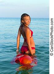 smiling teen girl in the sea