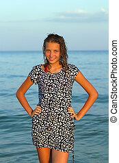 smiling teen girl in wet dress
